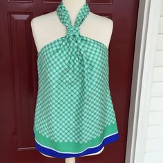 Banana Republic Top! Banana Republic gathered front tank top! Zipper in the back! Beautiful and sexy! Green, white and blue! Silk and fully lined with polyester! Great condition! 28 inches long. 17.5 chest laying flat measures across. Banana Republic Tops Blouses