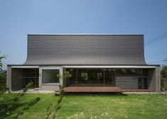 Curving roofline enhances acoustics inside house by NKS Architects