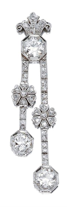 Diamond Pendant   Platinum, topped by one old European-cut diamond approximately .95 ct., accented by a diamond-set fleur-de-lys motif, supporting 2 straightlines of diamond-set bar links surmounted by 2 diamond-set florets, terminating in 2 old European-cut diamonds approximately 1.50 cts., circa 1915, approximately 5 dwt.