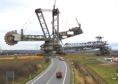 One of the largest mobile machines in the world crosses the road