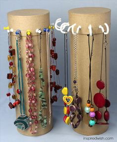 Awesome organisation project and repurpose project: cardboard tube (wine bottle holder, or even a paper towel tube) with push pins or C-hooks to store necklaces. This is a space-saver too! I would suggest weighting it with something like marbles or sand in the bottom so it isn't top-heavy and painting or decoupaging to make it pretty.