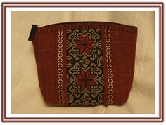 """One of two makeup bags I've made pattern for,  The hole """"body"""" of the bag is made entirely in the hoop.  (The pattern can be bought on Etzy or Epla.)"""