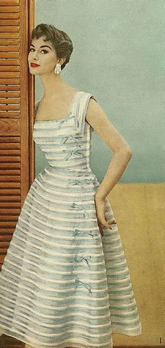 Adore this pale blue and white striped vintage dress with ribbons along the side c. 1954