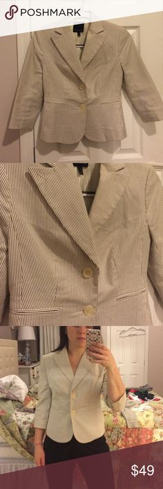 Striped Seersucker Blazer Rarely worn this blazer. It's white with blue/grey stripe. Sleeves are 3/4th length. It's a size 0 (my bust is a 32-34A) The Limited Jackets & Coats Blazers
