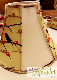 How to redo a lamp shade with fabric. I might be partial to this since the fabric is birds.