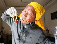 Piercing: This man understandably dribbles water after going through the ancient ritual of face-piercing