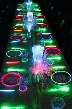 Glow in the dark table setting. New Year's Eve idea or night party dinner idea