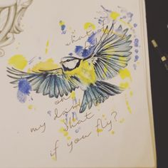Blue tit in flight. Colour bird tattoo design with ink splats.