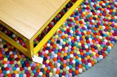 Squarepeg Home yellow table + large freckle rug