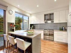 Modern u-shaped kitchen design using floorboards - Kitchen Photo 123831