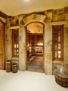 "Nice entrance to a wine cellar. I guess the space in the foreground is the ""tasting room""?"