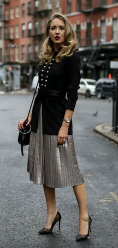 Pleated metallic midi skirt, military-inspired jacket with a black embossed waist belt, black shoulder bag, rose gold watch and black pumps Nyc Fashion, Holiday Fashion, Holiday Style, Style Fashion, Winter Skirt Outfit, Winter Outfits, Military Inspired Fashion, Mode Pop, Chic Outfits