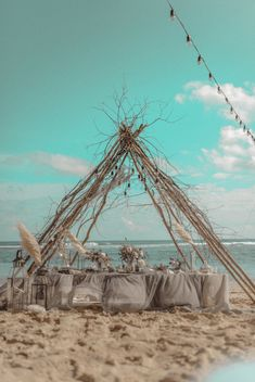 We just adore this intimate beach wedding - complete with tipi frame and string lights - so pretty and romantic. #WeddingInspiration #BeachWedding #IntimateWedding #RomanticWedding #WeddingDecor #WeddingPlanning