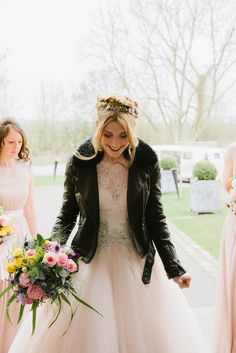Jade wore a leather jacket with her Allure Bridals gown. Photography by Ed Godden.