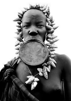 Mursi woman with her giant, painful, lip plate, a sign of beauty in Mursi tribe. When they are ready to marry, they start to make a hole in the lip with a wood stick.