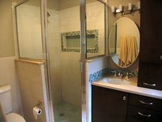 Knee wall is too tall but this idea.  Glass above the knee wall keeps the bath feeling open and airy and updated.