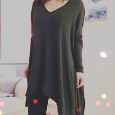 """oversized hunter green sweater Perfect knit top for the season. Two toned hunter green and black. Comfortable and oversized, yet trendy with slits down either side. Available is S, M, L. Second and third photo from retail website. New retail. No trades!  • 37"""" long • 38.1% rayon, 59.5% polyester, 2.4% spandex   *Please do not purchase this listing. Comment your size below and I will make you a listing* Sweaters V-Necks"""