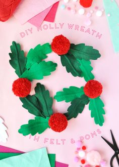 We really can't get enough of holly and wreaths! Check out our paper holly wreath! What our dreams are made of!
