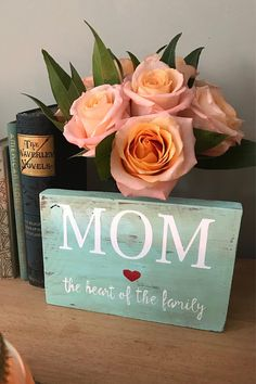 Mom the heart of the family Sign! These signs are hand crafted and one of a kind. Perfect gift for Mother's Day, hostess gift, shelf decoration or just a unique way to say Thank you to the most amazing woman you know, Mom. This cute little sign will add that special touch to an