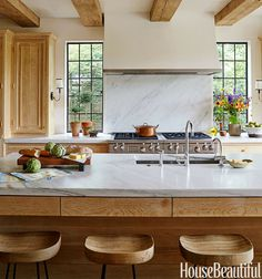 A Sunny Tudor Gets a Kitchen Revamp That's Just Modern Enough | HouseBeautiful.com