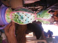 ubax-holder-for-flowers Somali, Captain Hat, Culture, Hats, Flowers, Hat, Flower, Hipster Hat, Blossoms