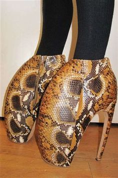 """Despite their unusual shape and towering 10"""" heel, these Alexander McQueen armadillo shoes have pleased as many shoe fetishists. Would you brave this daring footwear on a night out?"""