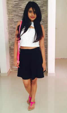 A go-to skater skirt styled in an easy casual way with a basic white crop top