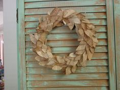 Wreath from old book pages.  Cut leaves, stain, and glue to foam wreath form that is covered with pages also.  DSC00014