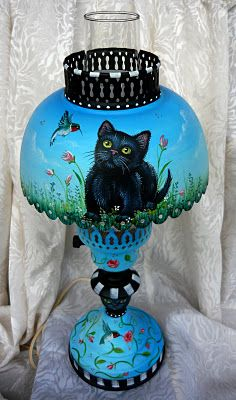 black cat painted on a lamp