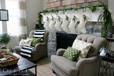 Family room Christmas decorating - white, black, green, and gold. From one of my favorite bloggers Jones Design Company.