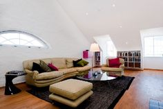 Amazing Attic of a House Ideas: Amazing Attic Of A House Ideas With Brown Sofas Combine With Glass Table Also Unique Standing Lamp And Black Rug Also Bookcase ~ youahh.com Attic Design Inspiration