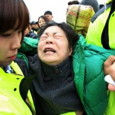 South Korea Ferry Death Toll Rises to 58 - Divers finally got into the boat, which sank Wednesday, and found more than a dozen bodies
