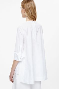 66a82c8a05cc7 This loose-fit top is made from soft cotton poplin with oversized folded  cuffs and