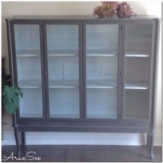 Available,uniquely beautiful  refurbished curio cabinet,chalk painted  soft grey and contrasting old white interior ,beveled glass doors with pewter knobs.