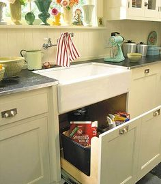 Farmhouse Sink Ideas for Cottage-Style Kitchens Super smart under the sink cabinet! So much easier to get to things. I also really like the color of the cabinets - not too white. Kitchen Redo, Kitchen And Bath, New Kitchen, Vintage Kitchen, Kitchen Remodel, Kitchen Dining, Kitchen Ideas, Rustic Kitchen, Apron Sink Kitchen