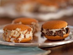 Mini Ice Cream Sandwiches by Ellie Krieger, the foodnetwork: These go together quickly with vanilla wafers, frozen yogurt or ice cream and crunchy coatings. #Ice_Cream_Sandwiches #thefoodnetwork #Ellie_Krieger