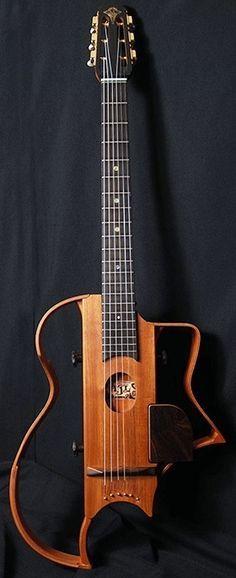 "AJL Guitars ""Quiet & Portable - silent travel guitar for gypsy swing player"" --- https://www.pinterest.com/lardyfatboy/"