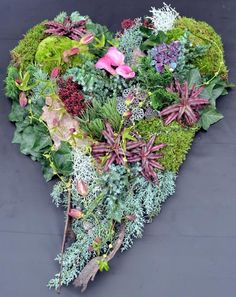 this would be lovely with Christmas berries and holly, etc. This says: Blumen Elsperger Weiss: Allerheiligen Grave Flowers, Funeral Flowers, Christmas Berries, Driftwood Wreath, Garden Workshops, Grave Decorations, Sympathy Flowers, Wedding Wreaths, Autumn Decorating