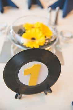 Mini record table numbers | Retro Inspired Musical Wedding With Rockabilly Flair | Photograph by BG Productions  http://storyboardwedding.com/retro-inspired-musical-wedding-rockabilly-flair/