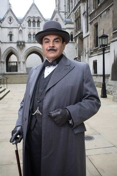 David Suchet in Agatha Christie's Poirot - Agatha Christie created Hercule Poirot towards the end of WWI. Described as a former shining light in the Belgian police, he was inspired by refugees from the country which Christie observed in Torquay, Devon. The character featured in her first novel, The Mysterious Affair at Styles (1920). Known for his waxed moustaches, perfectionism & 'little grey cells', Poirot became one of the most famous characters of all time.