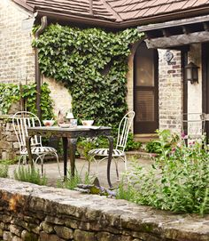 foxgloves, peonies, and pansies. A pair of flagstone patios, their walls covered in jasmine, clematis, and ivy,