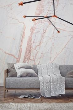 One of the hottest new trends in the world of wallcoverings is marble-print wallpaper. These swirly, fantastical papers range from more abstract, marbleized patterns to ones that are almost indistinguishable from actual stone.