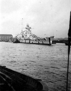 """German battlecruiser """"Scharnhorst"""" (1939-1943), with a baltic camouflage scheme, and turret tops painted red, on November/December 1940."""