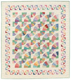 Whirling Fans by Nancy Mahoney. Create a beautiful fan quilt that sweeps you back in time to the 1930s. Click on http://www.shopmartingale.com/whirling-fans-quilt-epattern.html to download the pattern.