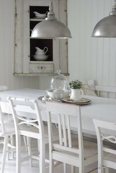 white mismatching dining chairs.
