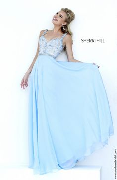New for 2015...Richly beaded lace appliques deck the A-line silhouette of Sherri Hill 8552 prom dress, fully enshrouding the sweetheart bodice. Metallic beadwork gilds the twin shoulder straps, transitioning into a more grandiose stretch running across the natural waist. From there, the full circle skirt peeks out and progresses onto the floor length with a sumptuous flounce. Also available in Coral, Ivory and Lilac.