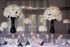 Tall white table centerpieces - white roses and hydrangea and candles | An Exquisite Black and White Styled Wedding Shoot at Da Paolo Bistro Bar