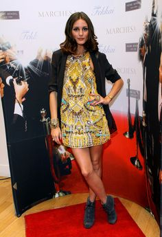 This time when she was wearing this crazy yellow dress with doodads on it.   29 Times We Wished We Could Trade Wardrobes With Olivia Palermo