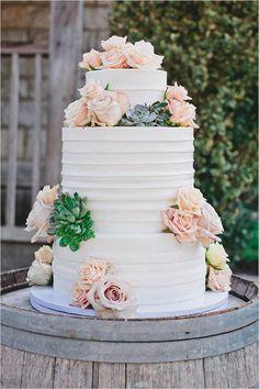 rose and succulent topped wedding cake @weddingchicks
