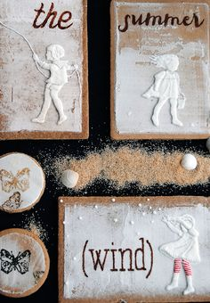 Sugar cookies with hand painted letters and silhouettes made with icing inspired from a vintage postcard! Beautiful!